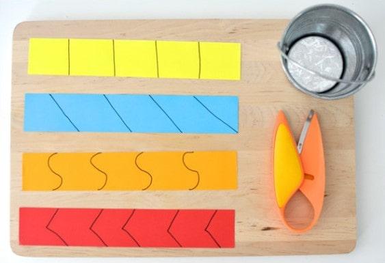 Оттачивание навыка вырезания из бумаги ножницами